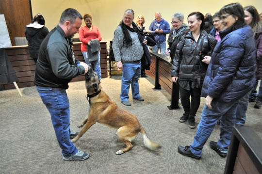 Brown Deer Investigator Josh Morgan plays with police dog Vader during his retirement party on Feb. 28.