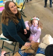 K-9 comfort dogs from Lutheran Church Charities came to the event. Allison's mom Tina Krueger (left) said she was happy they came.