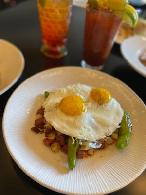 Corned beef hash with two sunny eggs and shishito peppers is one of the brunch dishes at Buckley's Restaurant, 801 N. Cass St., which recently expanded brunch to Saturday.