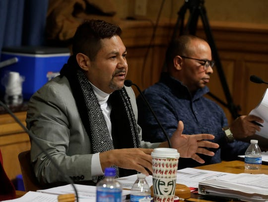 Nelson Soler, left, and Everett Cocroft, members of the Milwaukee Fire and Police Commission, are shown during a Dec. 18, 2019, meeting.