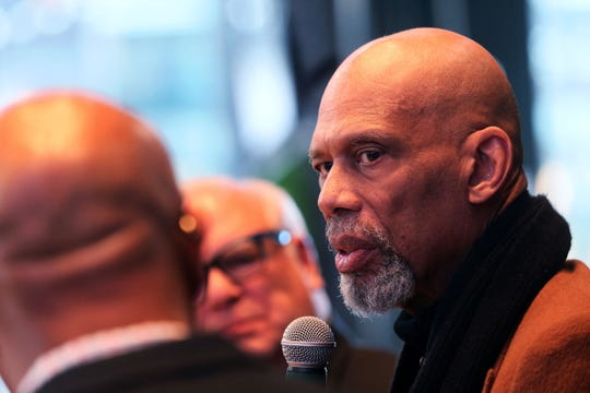 """Kareem Abdul-Jabbar, right, talks with Grady Crosby, left, and Jim Paschke, center, at the """"Diversity and Inclusion Conversation"""" at the MECCA Sports Bar and Grill."""