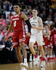 Wisconsin guard D'Mitrik Trice celebrates one of his five three-pointers Thursday night. Trice led the Badgers with 28 points.
