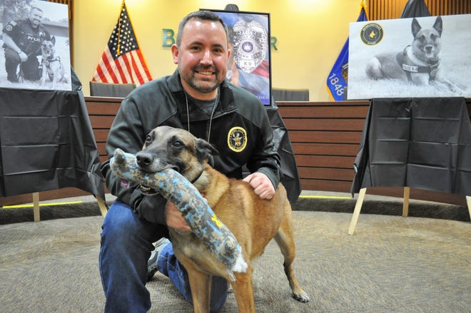 Josh Morgan, an investigator with the Brown Deer Police Department, poses with police dog Vader, who retired from duty Feb. 28 after eight years on the job.
