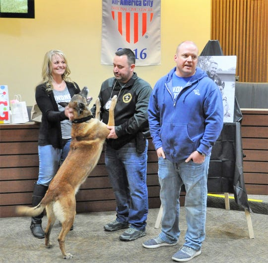 Brown Deer Police K9 Vader jumps up on his handler, Investigator Josh Morgan, while Geoff and Tammy Mertens thank him for visiting their 8-year-old daughter Emma, who died from a brain tumor in November. Their organization, the Emma Loves Dogs Foundation, donated $3,000 to the WisconsinLaw Enforcement Canine Handler Association at Vader's retirement party.