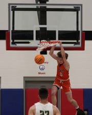 Viola's Blaine Marberry throws down a slam during the Longhorns' victory over Ridgefield Christian on Thursday night.