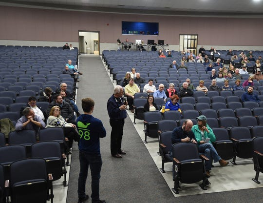 Area resident Joe Krieger address the audience during Thursday night's public meeting at Dunbar Auditorium to discuss a proposed community/aquatic center. The meeting drew a crowd of about 75 area residents.