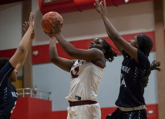 Ouachita's Lafaedria Green (24) goes for a shot over Northshore's defending Tyyunna Sylvas (2) and Soniyah Reed (14) during the quarter final playoff game at Ouachita High School in Monroe, La. on Feb. 27.