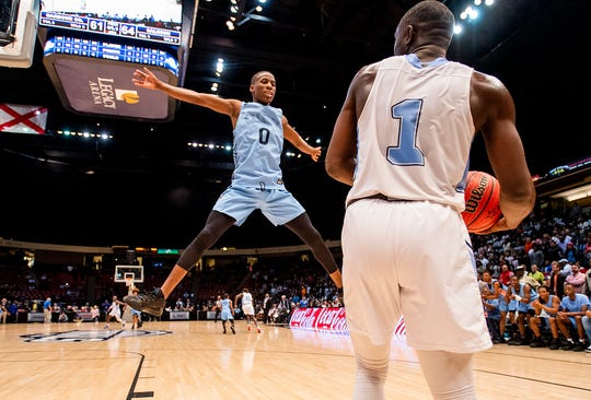 Calhoun's Trayvon Brown (0) defends the inbound pass with one second left against Barbour County in the AHSAA 2A boys basketball state championship game at Legacy Arena in Birmingham, Ala., on Friday February 28, 2020.