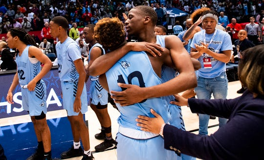 Calhoun celebrates defeating Barbour County in the AHSAA 2A boys basketball state championship game at Legacy Arena in Birmingham, Ala., on Friday February 28, 2020.