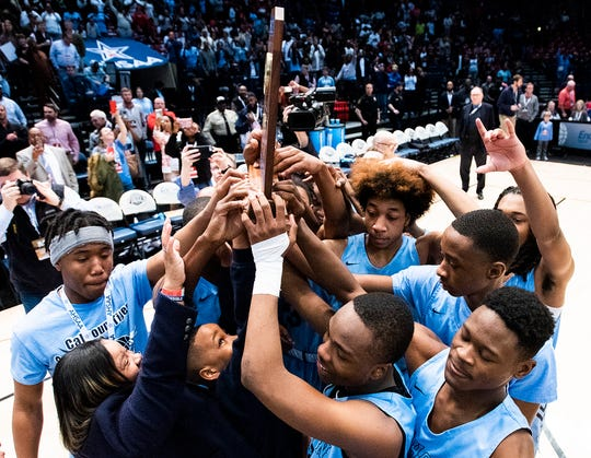 Calhoun claims their championship trophy after defeating Barbour County in the AHSAA 2A boys basketball state championship game at Legacy Arena in Birmingham, Ala., on Friday February 28, 2020.