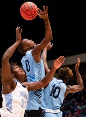 Calhoun's Trayvon Brown (0) grabs a rebound against Barbour County in the AHSAA 2A boys basketball state championship game at Legacy Arena in Birmingham, Ala., on Friday February 28, 2020.