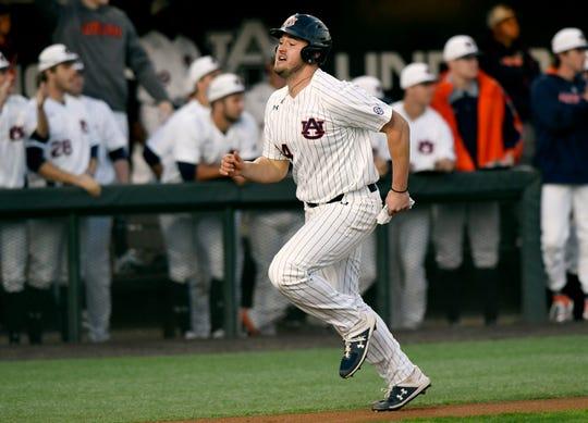 Auburn's Conor Davis scores a run against Illinois-Chicago on Friday, Feb. 14, 2020 in Auburn, Ala.
