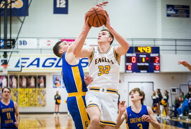 FILE -- Delta's Brady Hunt shoots past Greenfield-Central's defense during their game at Delta High School Thursday, Feb. 27, 2020.