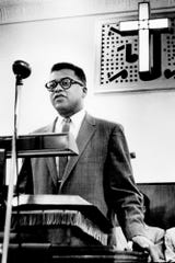 The Rev. James W. Lawson Jr. addresses a crowd at Gordon Memorial Methodist Church on Herman Street in a meeting on the lunch counter sit-ins March 7, 1960. Lawson, who studied Gandhi's techniques in Nagpur, India, conducted workshops on nonviolent strategy to aid Nashville students in ending segregation at lunch counters.
