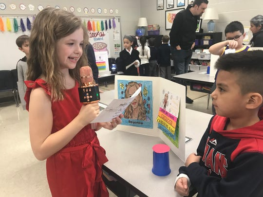 Poplar Grove Elementary second grade student Addyson Dunn embodies R&B superstar Beyonce as part of the Live Black History Museum on Thursday. She delivers a presentation to a museum visitor.