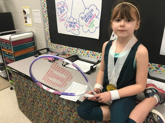 Second grade student and tennis player Zoey Parker depicted her favorite tennis player Serena Williams at the Poplar Grove Elementary School Live Black History Museum on Thursday. She holds a racket with Williams' name on it.