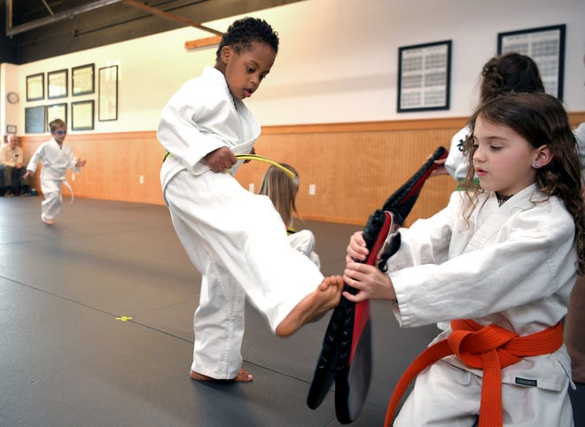 Hayden Harris, 6, who has Down syndrome, was picked to serve as an international ambassador for the organization Nothing Down, which raises awareness about Down syndrome. Pictured with Daisy Ketchum, 7, at Harvest Martial Arts in Franklin on Thursday, Feb. 28, 2020.