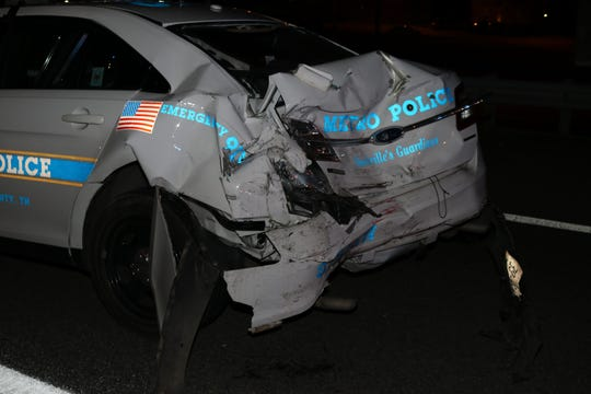 Police say a drunk driver drove her car into the back of a Metro Nashville police car on Thursday, Feb. 27, 2020, damaging it and injuring the officer driving it.