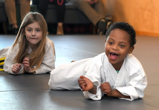 Hayden Harris, 6, who has Down syndrome, was picked to serve as an international ambassador for the organization Nothing Down, which raises awareness about Down syndrome.  Harris, right, takes a martial arts class at Harvest Martial Arts in Franklin on Thursday,  Feb. 28, 2020.