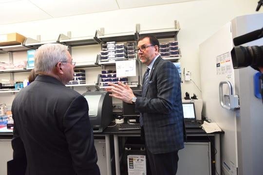 David S. Perlin, developer of a new rapid test to diagnose coronavirus, explains his research to U.S. Sen. Robert Menendez in this file photo. Perlin is chief scientific officer of the Center for Discovery and Innovation at Hackensack Meridian Health.