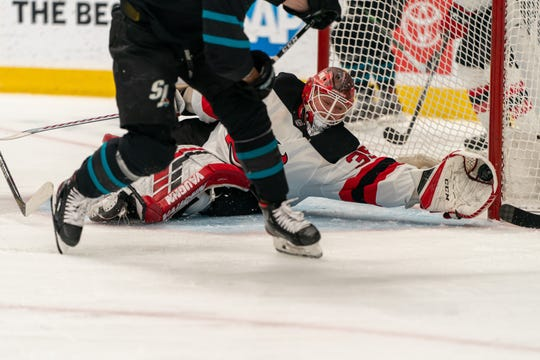 Feb 27, 2020; San Jose, California, USA;  New Jersey Devils goaltender Cory Schneider (35) makes a save against the San Jose Sharks during the second period at SAP Center at San Jose.