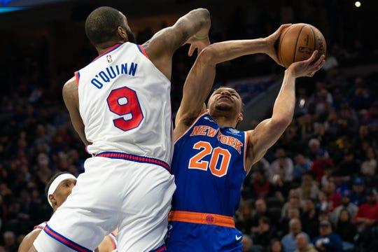 Feb 27, 2020; Philadelphia, Pennsylvania, USA; New York Knicks forward Kevin Knox II (20) drives for a shot attempt against Philadelphia 76ers center Kyle O'Quinn (9) during the second quarter at Wells Fargo Center.