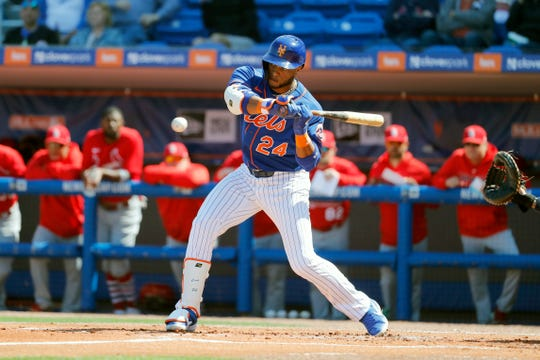 New York Mets' Robinson Cano bats during the first inning of a spring training baseball game against the St. Louis Cardinals Friday, Feb. 28, 2020, in Port St. Lucie, Fla.