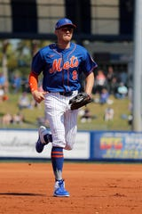 New York Mets center fielder Brandon Nimmo jogs to the dugout during the first inning of a spring training baseball game against the St. Louis Cardinals Friday, Feb. 28, 2020, in Port St. Lucie, Fla.