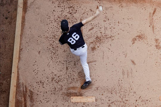 New York Yankees' Clarke Schmidt warms up during the fifth inning of a spring training baseball game against the Tampa Bay Rays Thursday, Feb. 27, 2020, in Tampa, Fla.