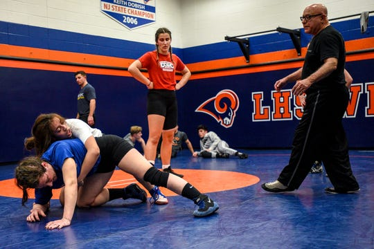 Natalie Vega a junior at Elmwood Park practices her technique with Immaculate Conception Wrestling Coach Meghan McHugh while Maria Taseva a junior at Elmwood Park and Nick DiDomenico watch during wrestling practice at Lodi High School on Thursday February 27, 2020.
