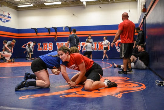 Maria Taseva (right) a junior at Elmwood Park practices a move with Immaculate Conception Wrestling Coach Meghan McHugh during wrestling practice at Lodi High School on Thursday February 27, 2020.