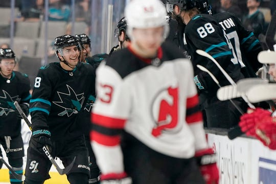 San Jose Sharks defenseman Mario Ferraro, left, celebrates with teammates after scoring a goal against New Jersey Devils during the second period of an NHL hockey game Thursday, Feb. 27, 2020, in San Jose, Calif.