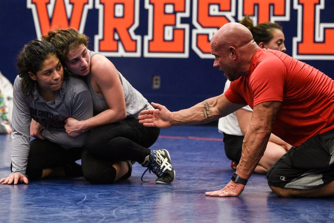Angela Valle a junior at Lodi and Brooke Tulloch a senior at Saddle Brook practice with Elmwood Park Assistant Coach Dennis Murri during wrestling practice at Lodi High School on Thursday February 27, 2020.