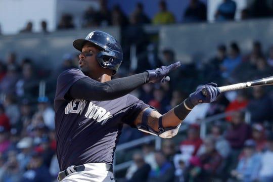 New York Yankees third baseman Miguel Andujar (41) bats against the Atlanta Braves during a spring training baseball game Friday, Feb. 28, 2020, in North Port, Fla.