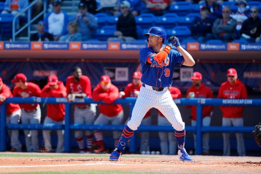New York Mets' Brandon Nimmo bats during the first inning of a spring training baseball game against the St. Louis Cardinals Friday, Feb. 28, 2020, in Port St. Lucie, Fla.