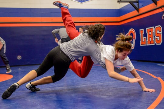 Angela Valle a junior at Lodi practices drills with Natalie Vega a junior at Elmwood Park during wrestling practice at Lodi High School on Thursday February 27, 2020.