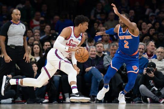 Feb 27, 2020; Philadelphia, Pennsylvania, USA; Philadelphia 76ers guard Matisse Thybulle (22) drives against New York Knicks guard Wayne Ellington (2) during the second quarter at Wells Fargo Center.