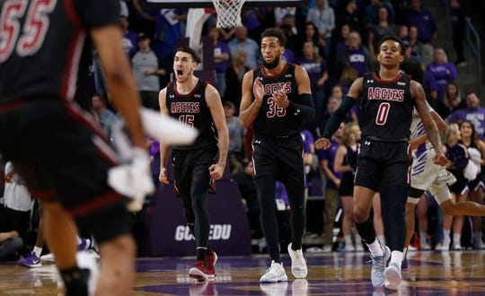 New Mexico State's Ivan Aurrecoechea (15) celebrates with his teammates after scoring and forcing a GCU timeout during the first half at Grand Canyon University in Phoenix, Ariz. on Feb. 27, 2020.