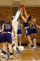 Carlsbad's Jaelee Bourque, left, blocks a Clovis shot during their District 4-5A semifinal game against Clovis on Feb. 27, 2020. Carlsad won, 32-21 and will face Hobbs for the championship on Saturday.