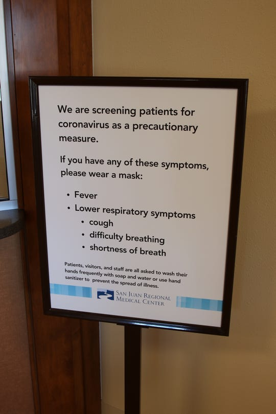 The placement of this sign in the emergency room at San Juan Regional Medical Center in Farmington is part of the institution's plan to address the spread of the coronavirus.