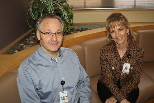San Juan Regional Medical Center's Dr. Brad Greenberg and Penny Hill, the infection prevention and employee health manager, say hospital officials are working hard to stay abreast of the latest developments in the spread of the novel coronavirus.