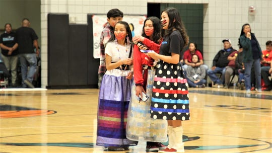 From right to left; Kierra Ford, Ajah-Rain Yellowhair, Lexie Quintana and Sahale James, members of Navajo Preparatory School's Naat'áani Youth Council's Cultural Committee, prepare to give a presentation on the murdered and missing indigenous women epidemic during halftime of a Prep basketball game at Navajo Prep's Eagles Nest gym in Farmington on Feb. 20, 2020.