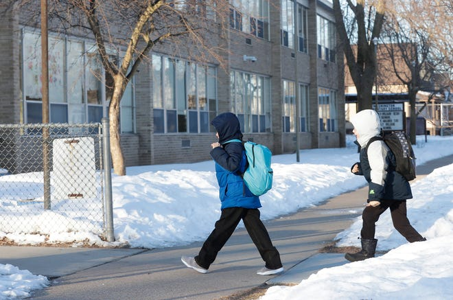 Children make their way to Washington Elementary School on Feb. 28 in Oshkosh. Consolidation plans included in a proposed $107.4 million referendum call for closing the school.