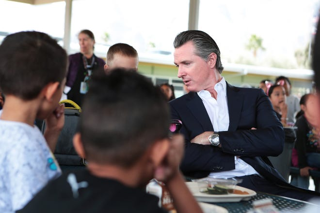 Gov. Gavin Newsom talks to first-graders at Vista Del Monte Elementary School in Palm Springs, Calif., on Feb. 28, 2020. Newsom visited the school to raise awareness and support for Proposition 13. The measure was defeated March 3 by voters statewide.
