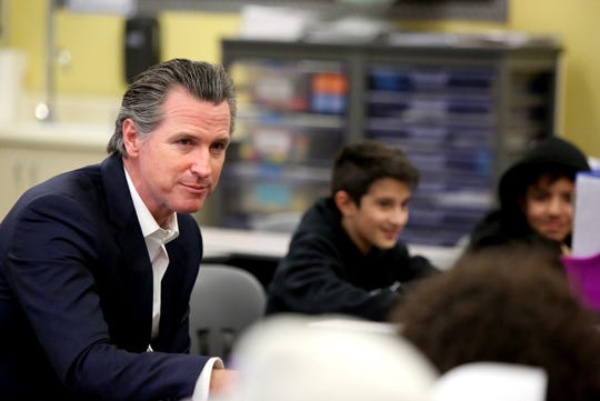 Gov. Gavin Newsom talks to fifth-graders at Vista Del Monte Elementary School in Palm Springs, Calif., on February 28, 2020. Newsom visited the school to raise awareness and support for Proposition 13.