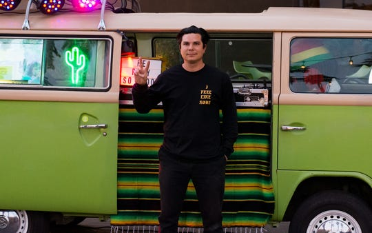 Rafael Lopez a.k.a. Alf Alpha poses in front of his Volkswagen bus that's also a DJ booth in front of the Hyatt Palm Springs in Palm Springs, Calif. on Feb. 13, 2020.