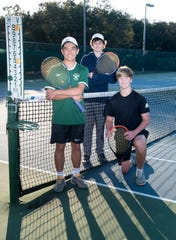 Pensacola Catholic High School tennis players (from left) Patrick Ling, Evan Fisher, and Justin Lyons pose during  practice at the Roger Scott Tennis Center in Pensacola on Thursday, Feb. 27, 2020.