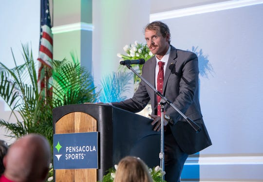 Brock Sakey speaks at the Pensacola Sports Annual Awards Banquet. His father, Brian Sakey, was posthumously inducted into Pensacola Sports Hall of Fame the during the banquet on Thursday.