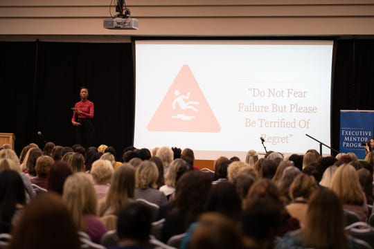 """Army Capt. and former Miss USA Deshauna Barber presents """"I Don't Like Being Told 'It's a Man's World' """" on Friday during the seventh annual Women in Leadership Conference at the University of West Florida Conference Center."""