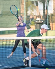 The Pensacola Catholic tennis team practices at Roger Scott Tennis Center in late February. The tennis community has eagerly awaited a full-fledged return to courts and was granted a gradual step in that direction on Friday.